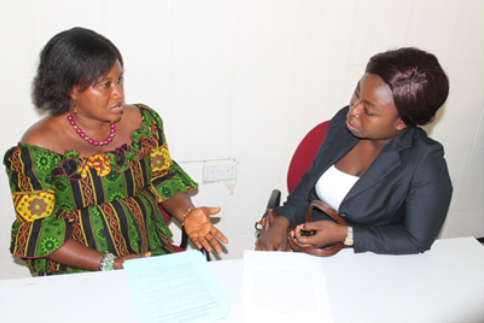The researcher-Benedicta Ahomah Bioh (right) interviewing the Municipal Girl Child Coordinator (Winneba Municipal GES Office), Mrs. Faustina Akosua Agyeiwaa Kwofie.