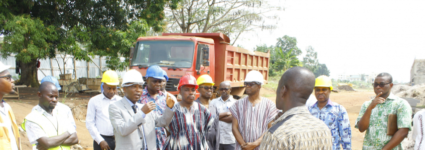 Development Officer, Ing. Eric Amankwah briefing the Principal and his team at the project site